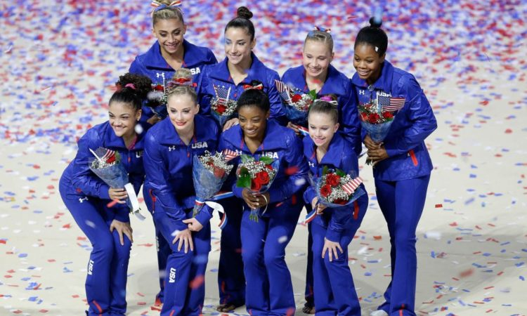 U.S. Olympic women's gymnastics team members, clockwise from top left: Ashton Locklear, Aly Raisman, Madison Kocian, Gabby Douglas, Ragan Smith, Simone Biles, MyKayla Skinner and Laurie Hernandez (© AP Images)