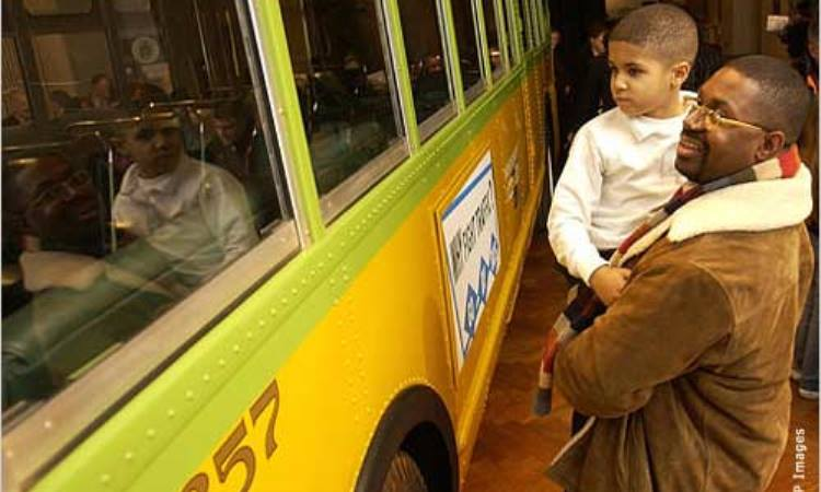 A man and his son see the bus in which Rosa Parks refused to give up her seat in 1955, a landmark in the civil rights movement. (AP Image)